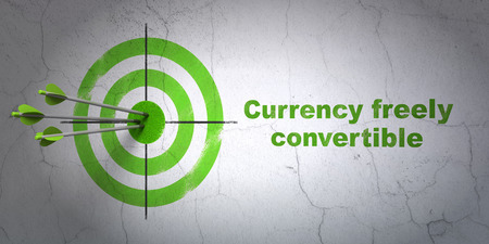 freely: Success currency concept: arrows hitting the center of target, Green Currency freely Convertible on wall background