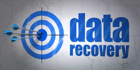 data recovery: Success Data concept: arrows hitting the center of target, Blue Data Recovery on wall background