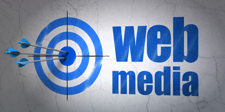 media center: Success web development concept: arrows hitting the center of target, Blue Web Media on wall background Stock Photo