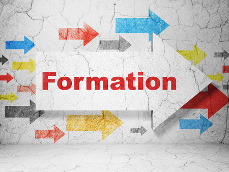 formations: Learning concept:  arrow with Formation on grunge textured concrete wall background