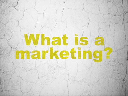 what: Advertising concept: Yellow What is a Marketing? on textured concrete wall background