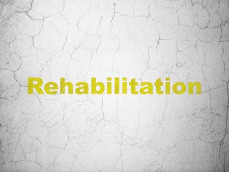rehabilitation: Healthcare concept: Yellow Rehabilitation on textured concrete wall background Stock Photo