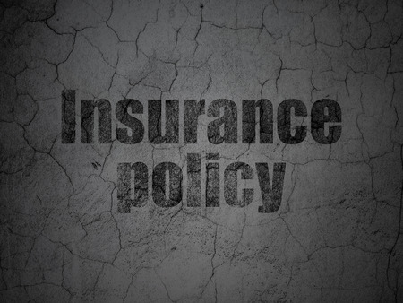 insurance policy: Insurance concept: Black Insurance Policy on grunge textured concrete wall background