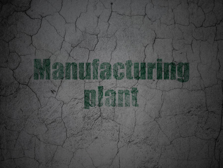 manufacturing plant: Manufacuring concept: Green Manufacturing Plant on grunge textured concrete wall background