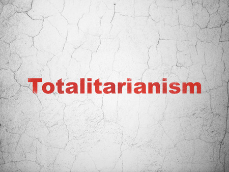totalitarianism: Politics concept: Red Totalitarianism on textured concrete wall background