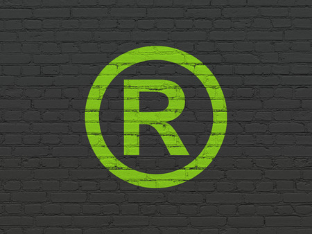 r regulation: Law concept: Painted green Registered icon on Black Brick wall background