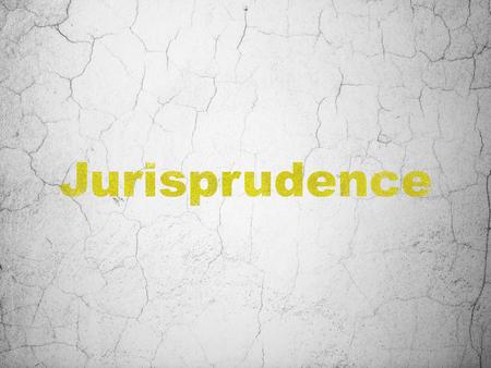 jurisprudencia: Concepto de la ley: Jurisprudencia amarillo en el fondo muro de hormigón con textura