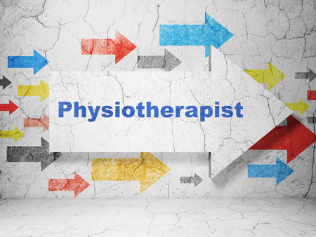physiotherapist: Healthcare concept:  arrow with Physiotherapist on grunge textured concrete wall background Stock Photo