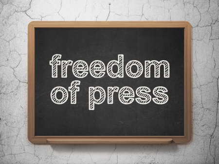 Political concept: text Freedom Of Press on Black chalkboard on grunge wall background