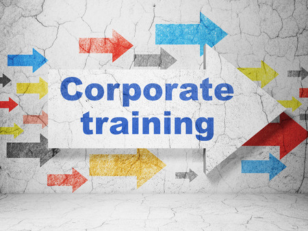 corporate training: Studying concept:  arrow with Corporate Training on grunge textured concrete wall background Stock Photo
