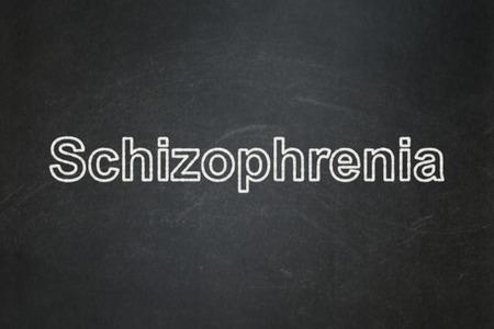 schizophrenia: el concepto de salud: La esquizofrenia texto sobre fondo de pizarra Negro