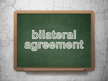 bilateral: Insurance concept: text Bilateral Agreement on Green chalkboard on grunge wall background