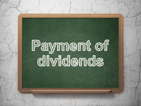 dividends: Currency concept: text Payment Of Dividends on Green chalkboard on grunge wall background Stock Photo