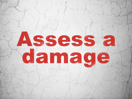 assess: Insurance concept: Red Assess A Damage on textured concrete wall background