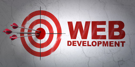 hitting a wall: Success web development concept: arrows hitting the center of target, Red Web Development on wall background