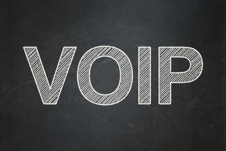 voip: Web design concept: text VOIP on Black chalkboard background