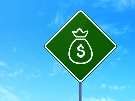 way bill: Currency concept: Money Bag on green road highway sign, clear blue sky background, 3d render Stock Photo