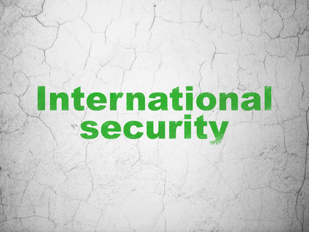 international security: Security concept: Green International Security on textured concrete wall background Stock Photo