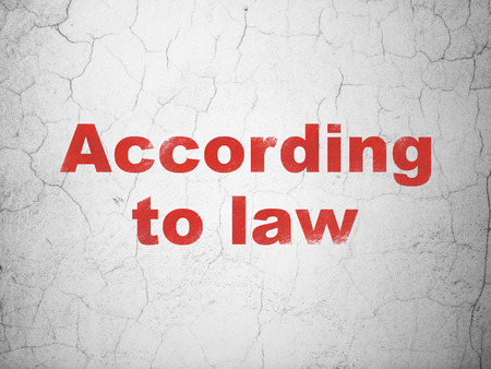 according: Law concept: Red According To Law on textured concrete wall background Stock Photo