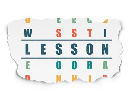 word lesson: Studying concept: Painted blue word Lesson in solving Crossword Puzzle on Torn Paper background