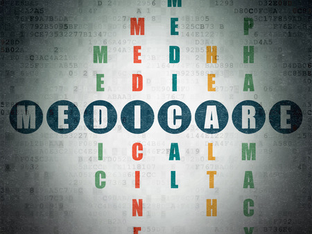 medicare: Health concept: Painted blue word Medicare in solving Crossword Puzzle on Digital Paper background Stock Photo