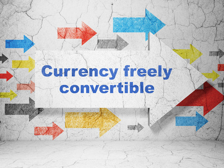 freely: Banking concept:  arrow with Currency freely Convertible on grunge textured concrete wall background, 3D rendering Stock Photo