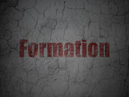 formation: Education concept: Red Formation on grunge textured concrete wall background