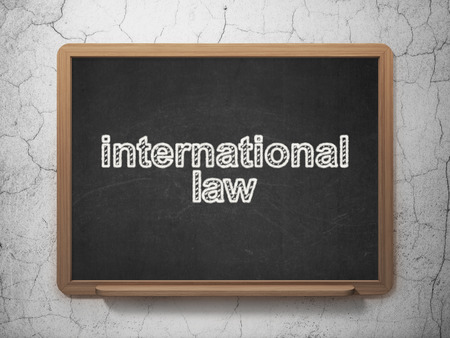 international law: Politics concept: text International Law on Black chalkboard on grunge wall background, 3D rendering