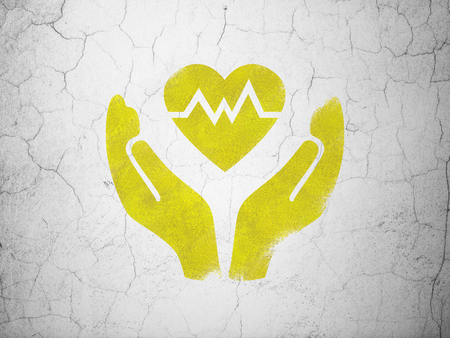 yellow heart: Insurance concept: Yellow Heart And Palm on textured concrete wall background Stock Photo