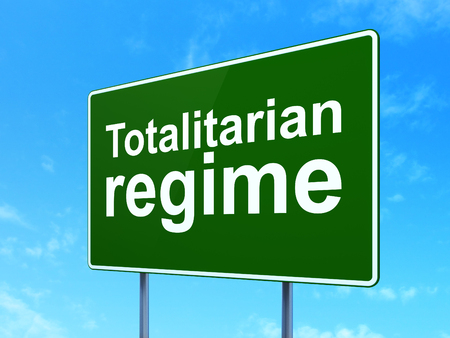 regime: Politics concept: Totalitarian Regime on green road highway sign, clear blue sky background, 3D rendering Stock Photo
