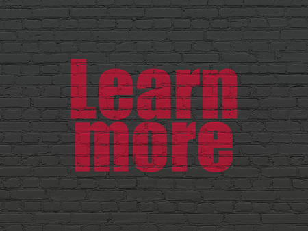 more information: Studying concept: Painted red text Learn More on Black Brick wall background Stock Photo