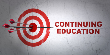 continuing education: Success Education concept: arrows hitting the center of target, Red Continuing Education on wall background, 3D rendering