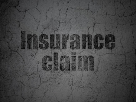 insurance claim: Insurance concept: Black Insurance Claim on grunge textured concrete wall background