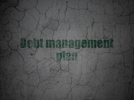 debt management: Finance concept: Green Debt Management Plan on grunge textured concrete wall background