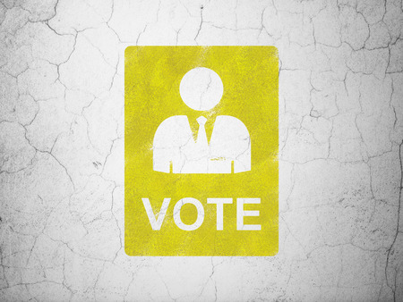 Politics concept: Yellow Ballot on textured concrete wall background Stock Photo