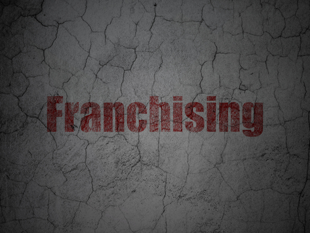 franchising: Business concept: Red Franchising on grunge textured concrete wall background