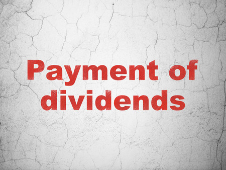dividends: Currency concept: Red Payment Of Dividends on textured concrete wall background