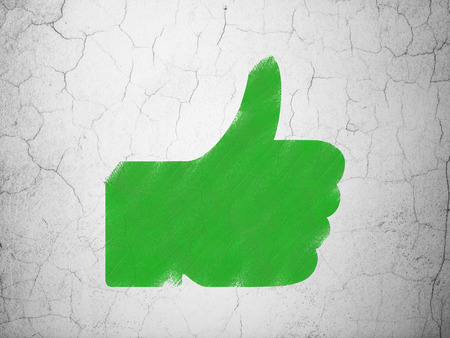 green thumb: Social media concept: Green Thumb Up on textured concrete wall background