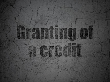 granting: Currency concept: Black Granting of A credit on grunge textured concrete wall background Stock Photo