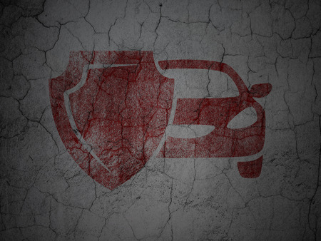 insured: Insurance concept: Red Car And Shield on grunge textured concrete wall background