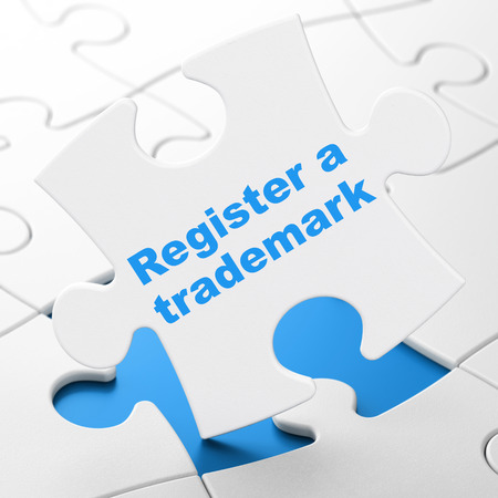 brainteaser: Law concept: Register A Trademark on White puzzle pieces background, 3D rendering Stock Photo