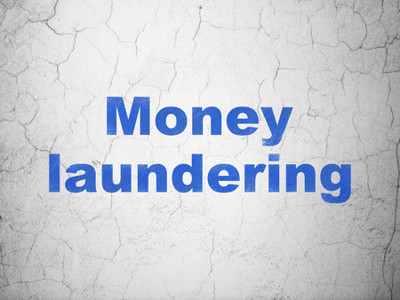 laundering: Money concept: Blue Money Laundering on textured concrete wall background Stock Photo