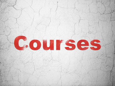 antique sleigh: Education concept: Red Courses on textured concrete wall background Stock Photo