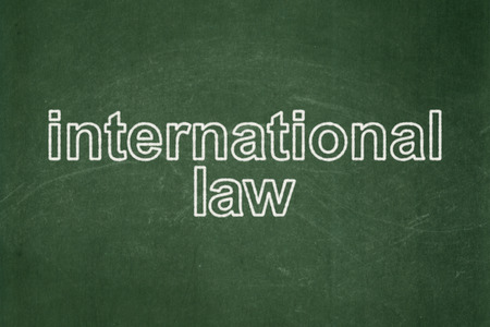 international law: Political concept: text International Law on Green chalkboard background