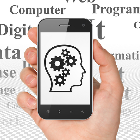 head tag: Information concept: Hand Holding Smartphone with  black Head With Gears icon on display,  Tag Cloud background, 3D rendering