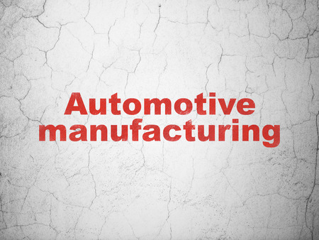automotive industry: Industry concept: Red Automotive Manufacturing on textured concrete wall background