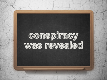 revealed: Politics concept: text Conspiracy Was Revealed on Black chalkboard on grunge wall background, 3D rendering
