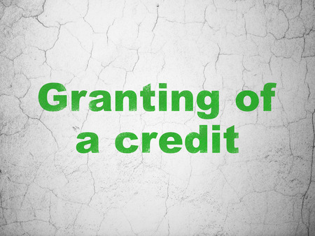 granting: Currency concept: Green Granting of A credit on textured concrete wall background Stock Photo