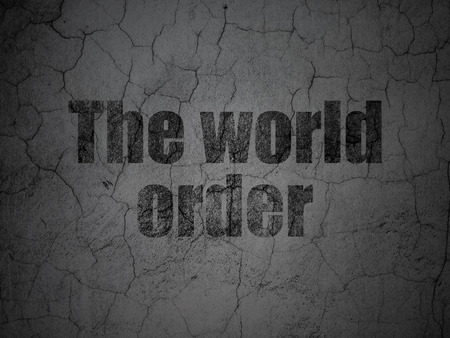 dictatorship: Political concept: Black The World Order on grunge textured concrete wall background