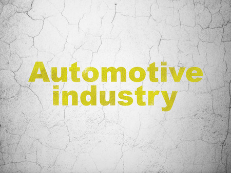 automotive industry: Manufacuring concept: Yellow Automotive Industry on textured concrete wall background